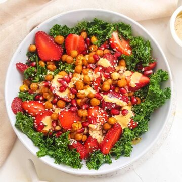 Vegan Kale Salad topped with chickpeas and tahini dressing