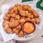 vegan Fried cauliflower served in a plate with dip on side