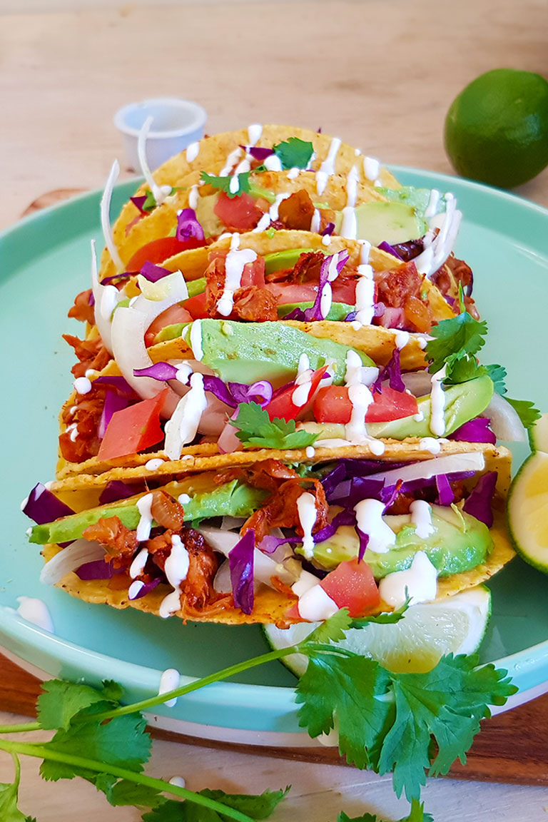 hard shell tacos filled with pulled jackfruit taco meat