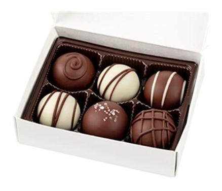 white chocolate box with vegan chocolate truffles