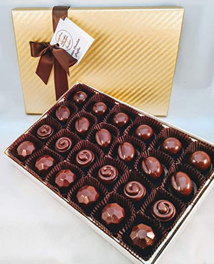 chocolate box with golden lid and brown ribbon