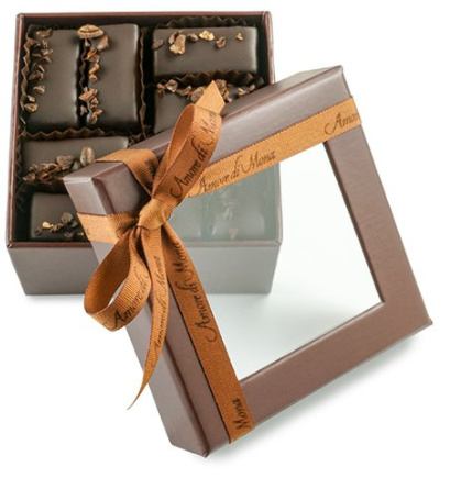 brown color transparent lid chocolate box and ribbon.