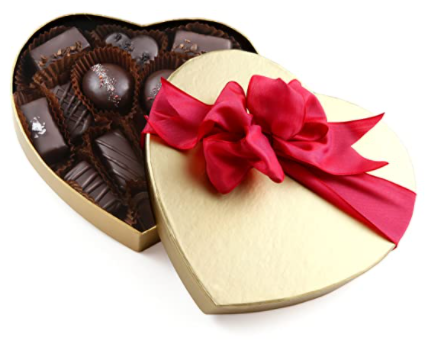 golden heart shape chocolate box with red ribbon