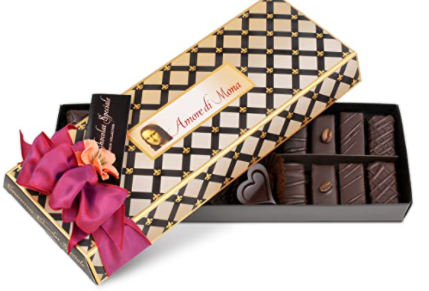 golden box of vegan chocolates with pink ribbon on top