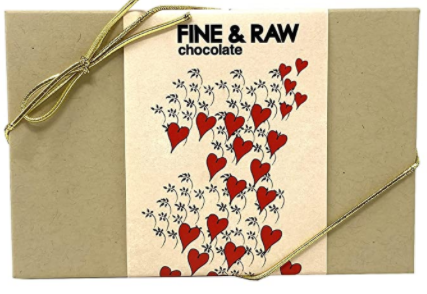 vegan chocolate paper box with printed red hearts on it