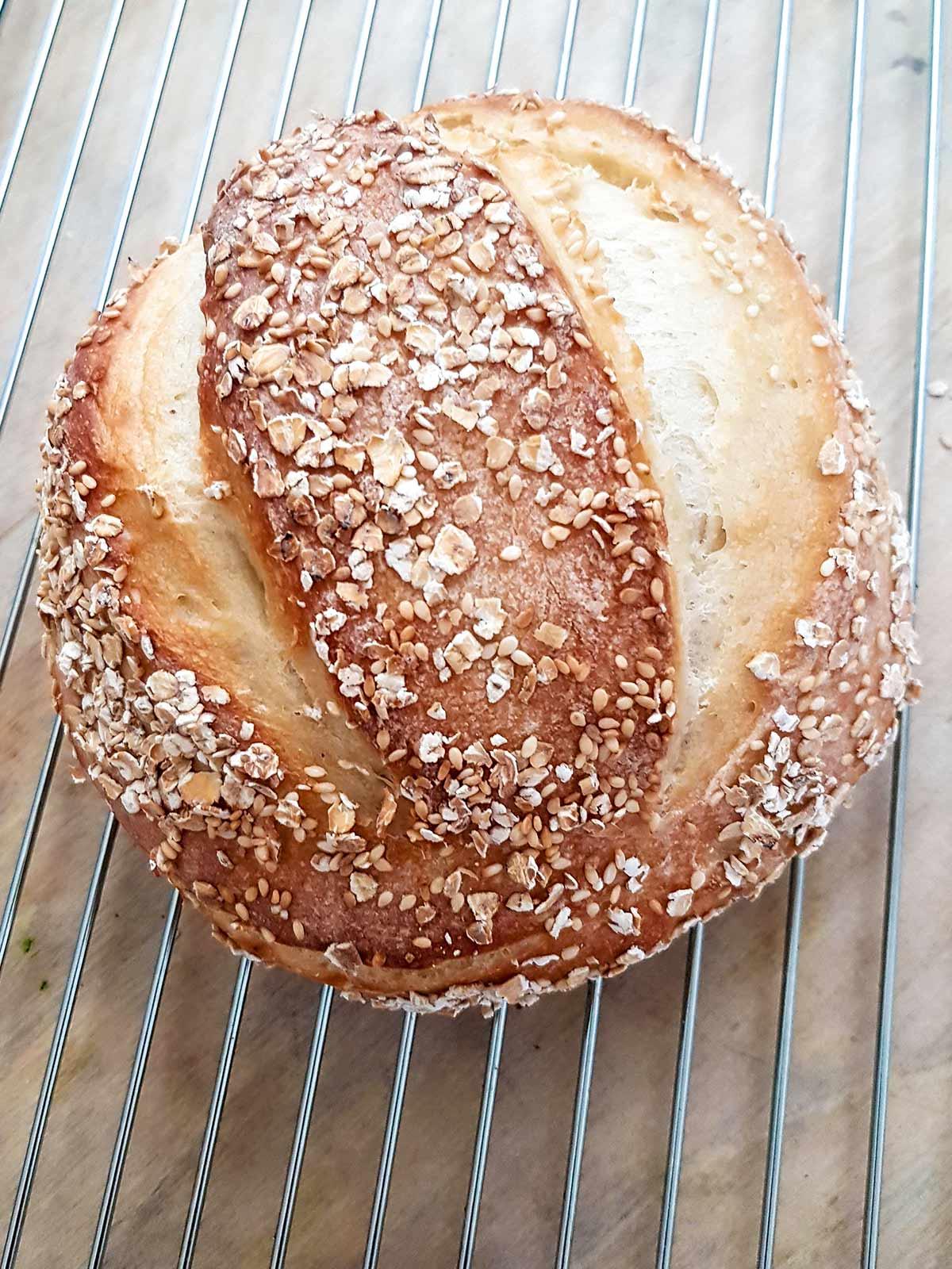 bread loaf cooling on steel rack