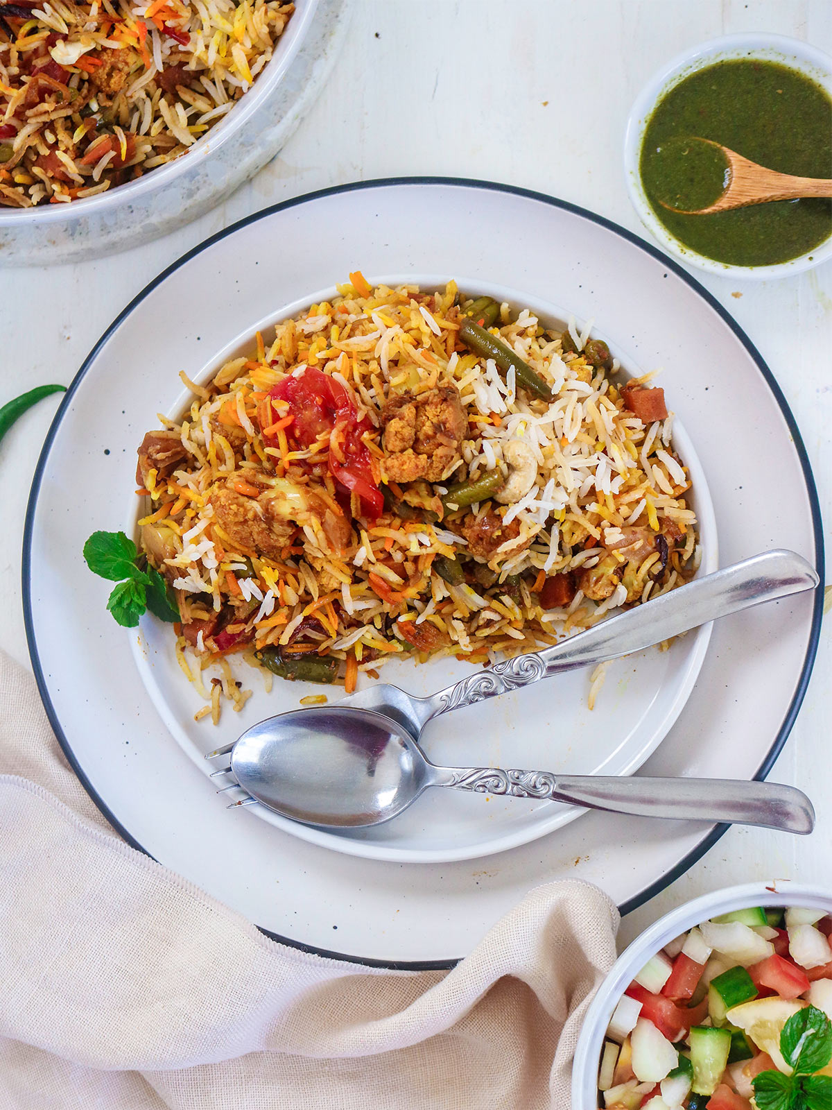 vegan biryani served in a plate with spoon and fork
