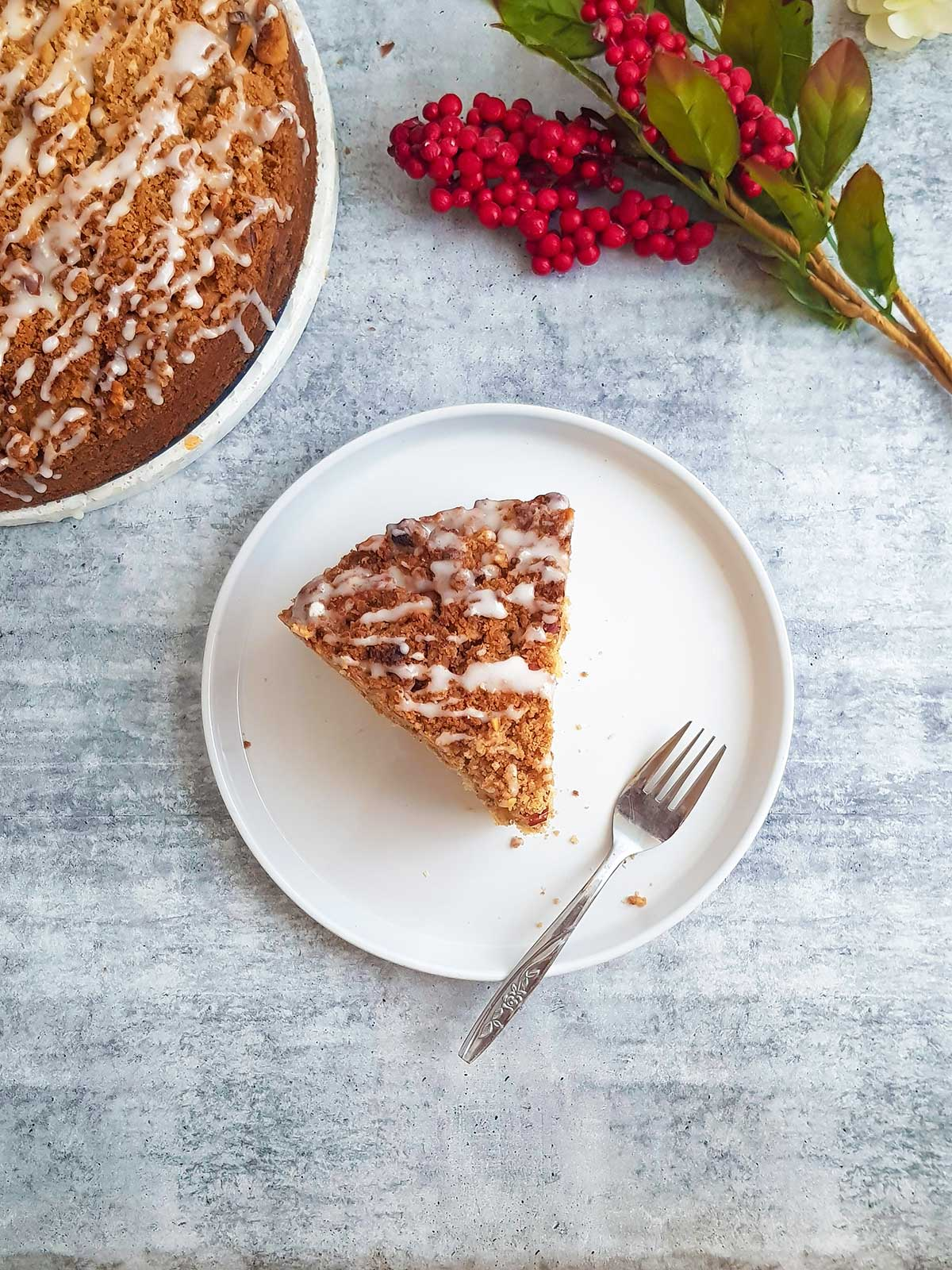 coffee cake slice served in a white plate with fork.