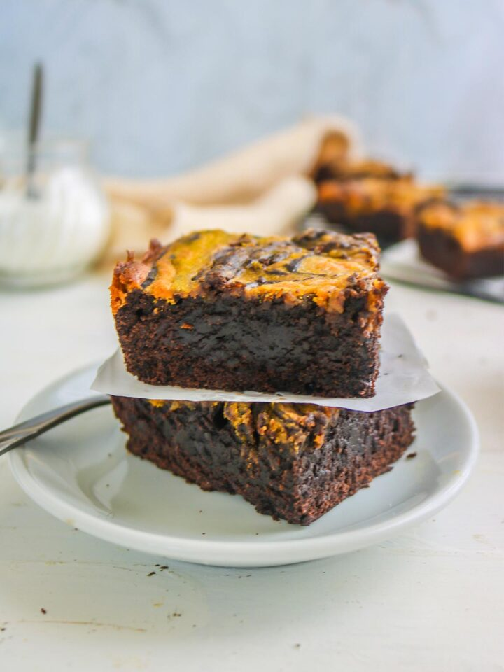 vegan pumpkin brownies served with white plate and fork