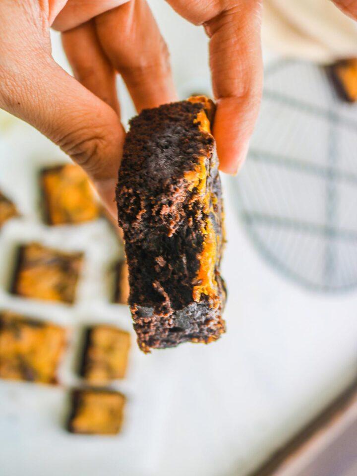 vegan pumpkin brownies in hands