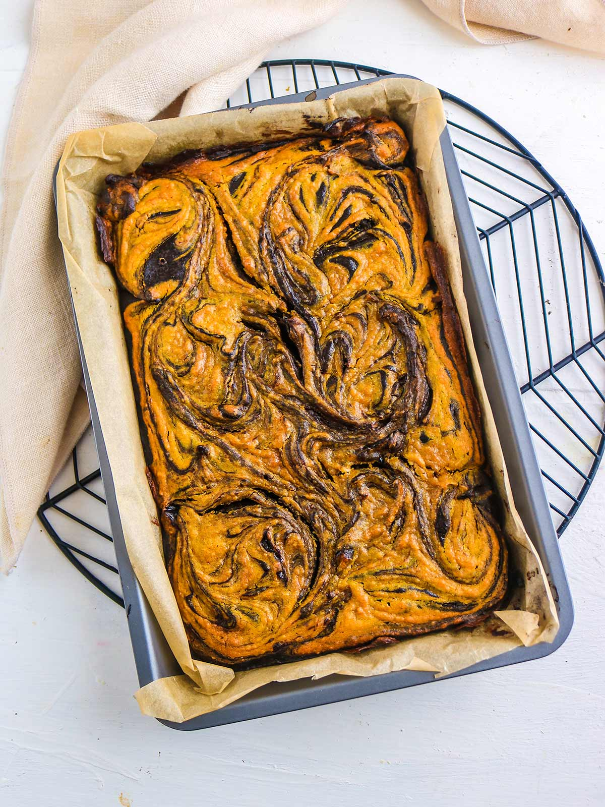 vegan pumpkin brownies out of oven before slicing