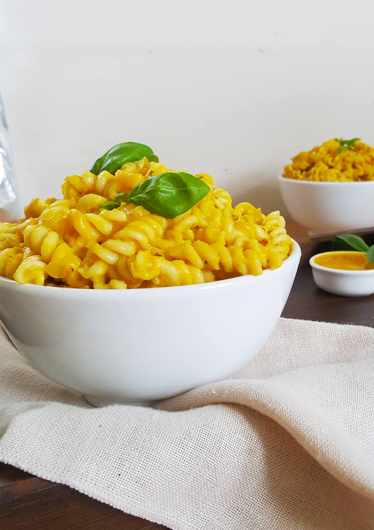 pumpkin pasta served in two white bowls