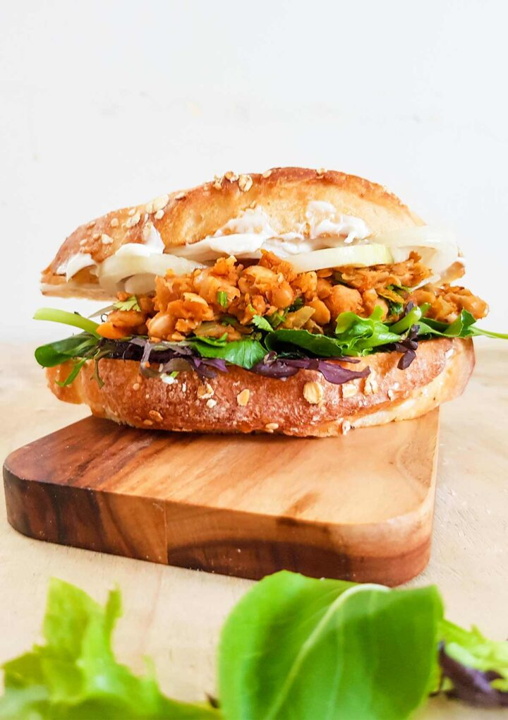 vegan chickpea sandwich placed  on a wooden board
