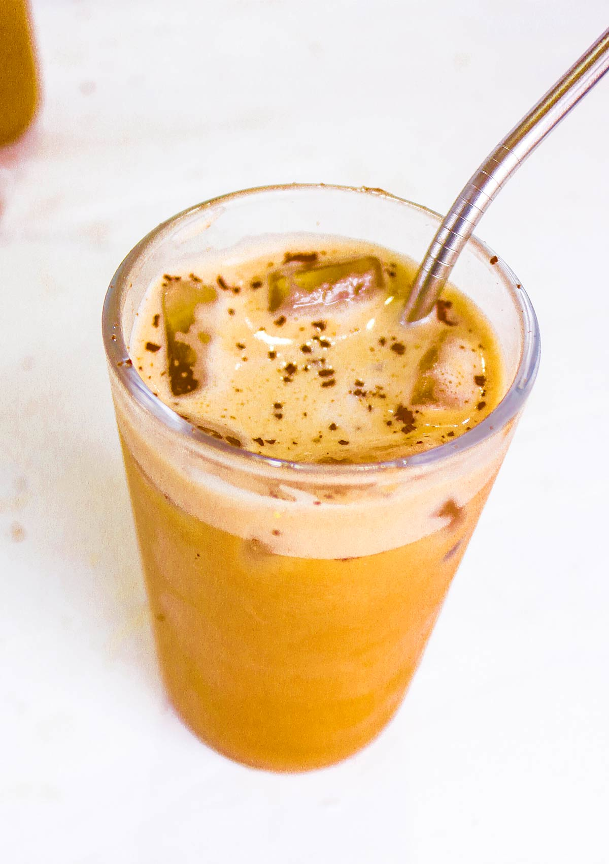 perfect iced coffee made will oat milk in a glass jar