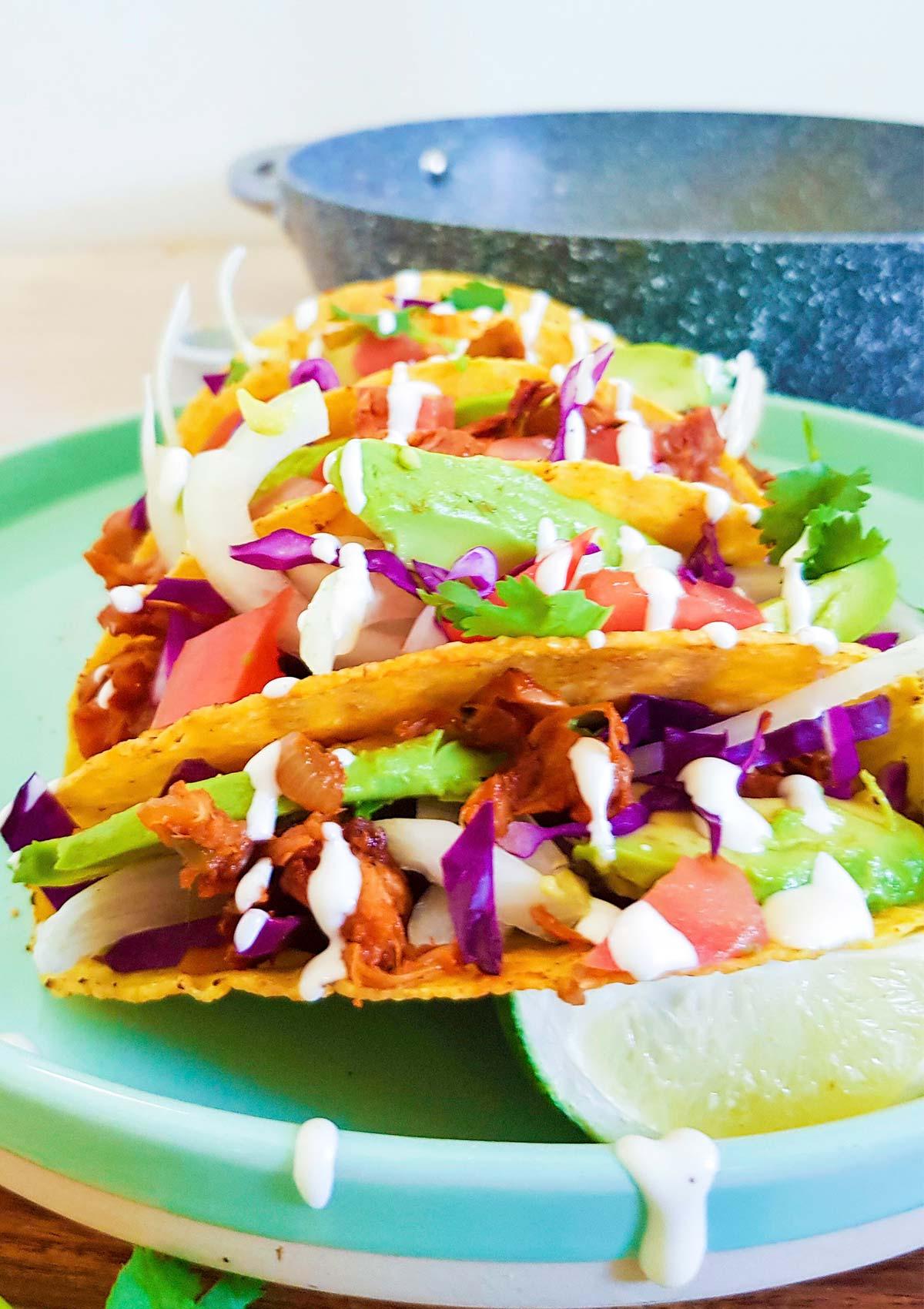 Jackfruit tacos topped with vegan sour cream