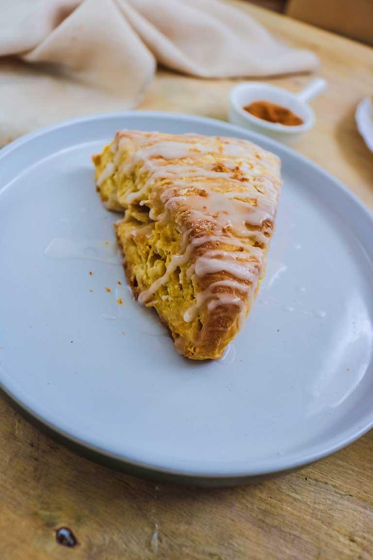pumpkin scone served in a white plate