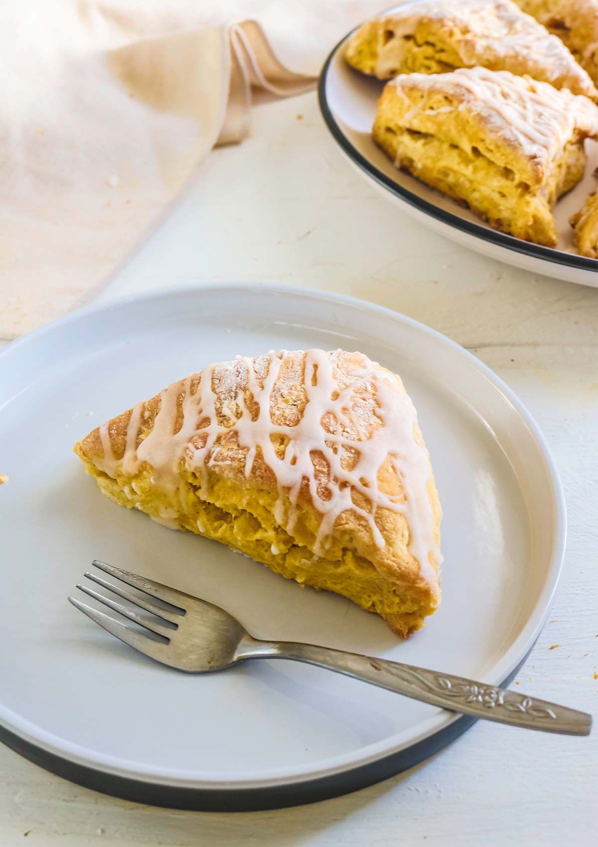 pumpkin scone served in a plate with fork