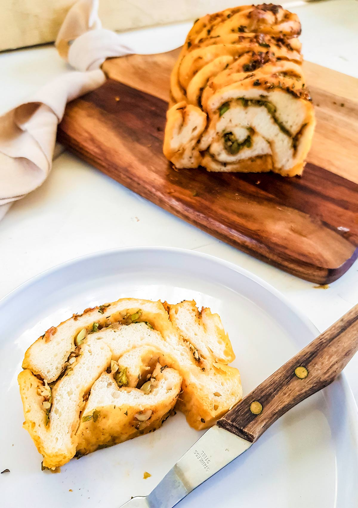 savory babka slice in a plate with fork