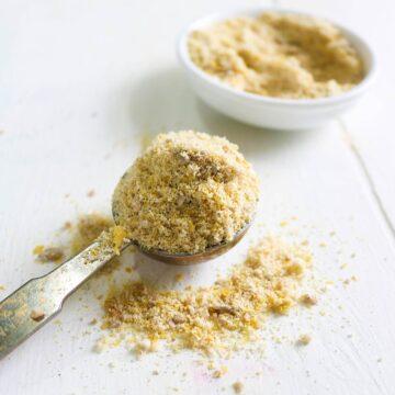 vegan parmesan cheese in a spoon